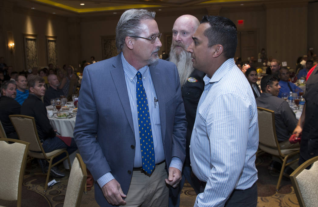 Small business owner Ron Nelsen, left, is told to leave after interrupting U.S. Sen. Dean Heller, R-Nev., during a luncheon to discuss infrastructure projects at the Suncoast hotel-casino Friday,  ...