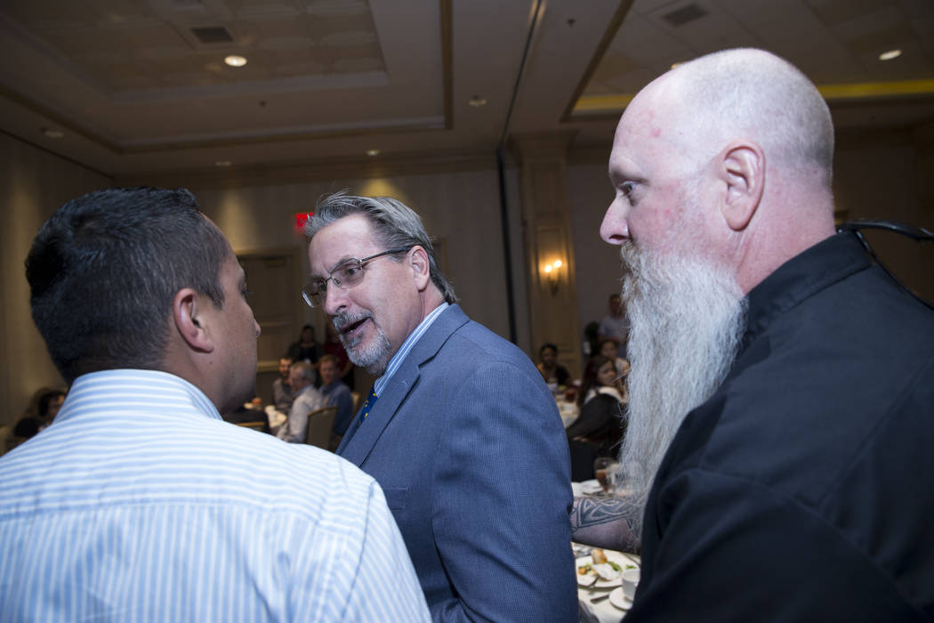 Small business owner Ron Nelsen, center, is told to leave after interrupting U.S. Sen. Dean Heller, R-Nev., during a luncheon to discuss infrastructure projects at the Suncoast casino-hotel on Fri ...