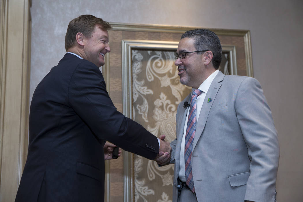 U.S. Sen. Dean Heller, R-Nev., left, and Peter Guzman, president of the Latin Chamber of Commerce, during the monthly Latin Chamber of Commerce luncheon to discuss infrastructure projects at the S ...