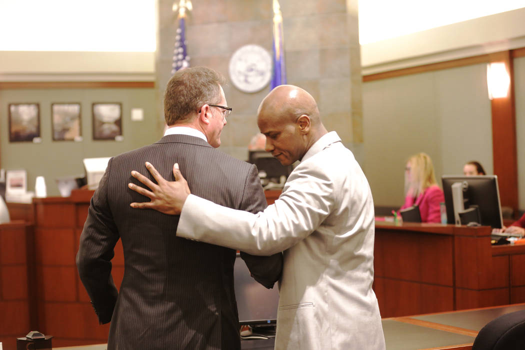 Defense attorney Robert Draskovich, left, hugs his client Frederick Richards, a former Bellagio club host who was just acquitted on all counts of kidnapping and two charges of sexual assault on Th ...