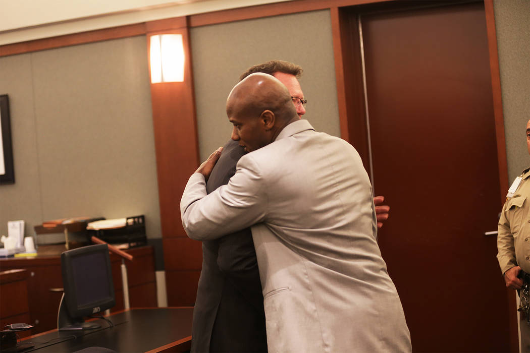Defense attorney Robert Draskovich, left, hugs his client Frederick Richards, a former Bellagio club host who was acquitted of kidnapping and sexual assault charges on Thursday, May 11, 2017, at t ...