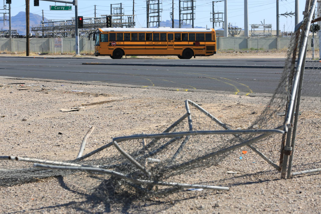 A Clark County School District bus, on Friday, May 5, 2017, passes by the scene of Thursday's crash that killed one and cause a school bus to roll over in Las Vegas. Brett Le Blanc Las Vegas Revie ...