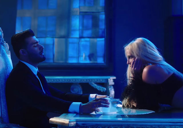 "Sam Asghari and Britney Spears appear in the music video for Spears' ""Slumber Party."""