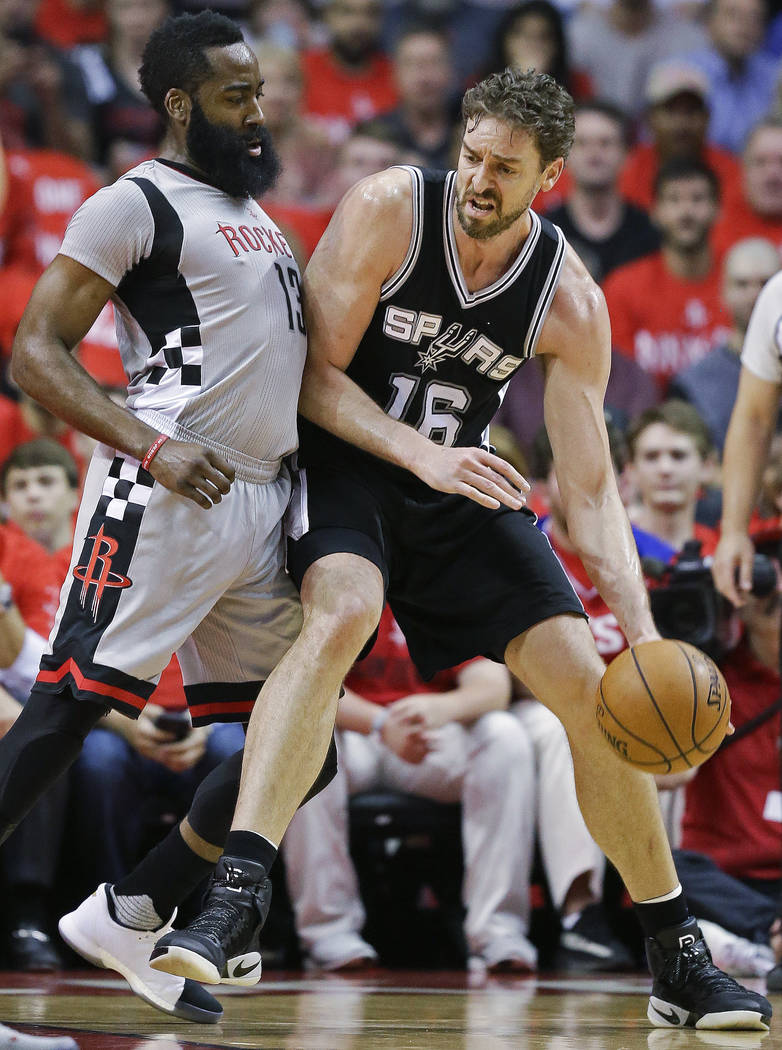 San Antonio Spurs center Pau Gasol, right, dribbles as Houston Rockets guard James Harden defends during the first half in Game 6 of an NBA basketball second-round playoff series, Thursday, May 11 ...