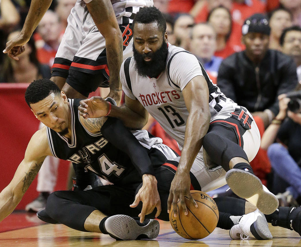 Houston Rockets guard James Harden (13) and San Antonio Spurs guard Danny Green chase a loose ball during the second half in Game 6 of an NBA basketball second-round playoff series, Thursday, May  ...