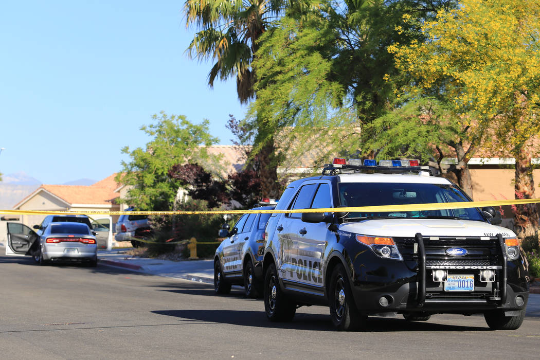 Las Vegas police investigate a shooting during a home invasion in the 6300 block of Chimney Wood Avenue on Friday, May 12, 2017. (Brett Le Blanc Las Vegas Review-Journal) @bleblancphoto