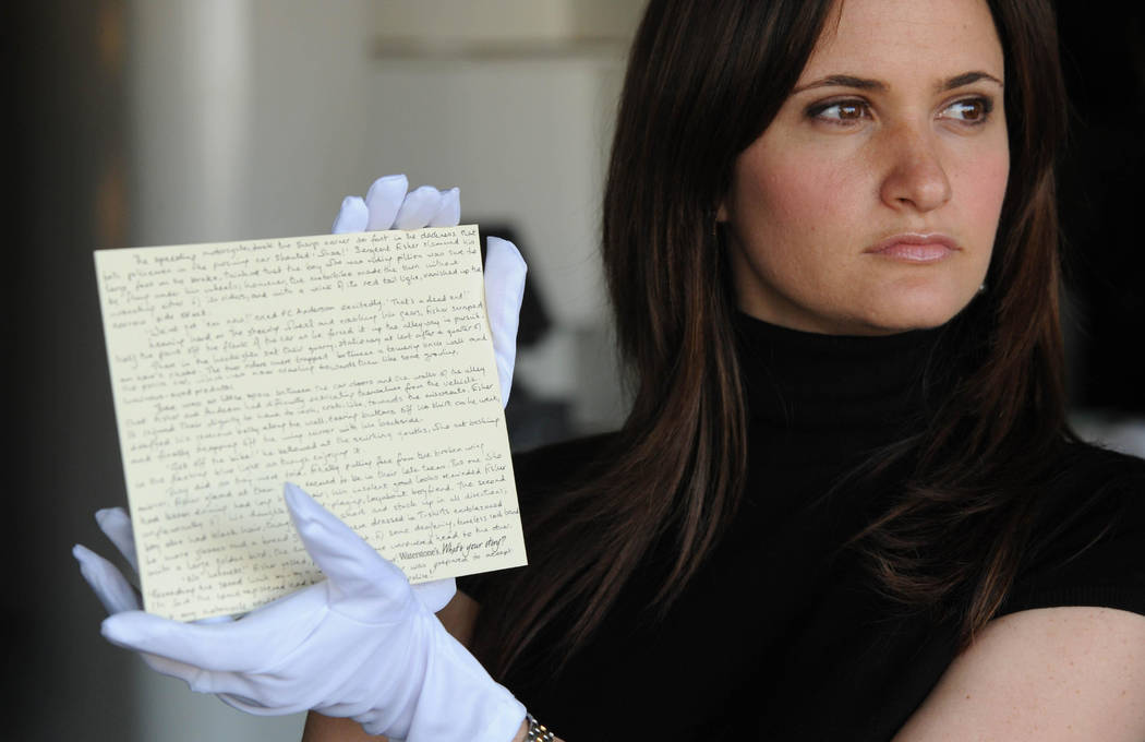 A member of staff at Waterstones holds a story written by JK Rowling donated by the author, for the What's Your Story? auction in aid of English PEN and Dyslexia Action, in London on  June 10, 200 ...