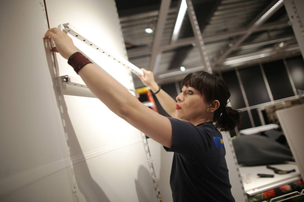 Veronica Jefferis remodels a section on Monday, May 15, 2017, in the home textiles area at Ikea in Las Vegas. The one year anniversary of Ikea is Thursday. Ikea is revamping parts of the home text ...