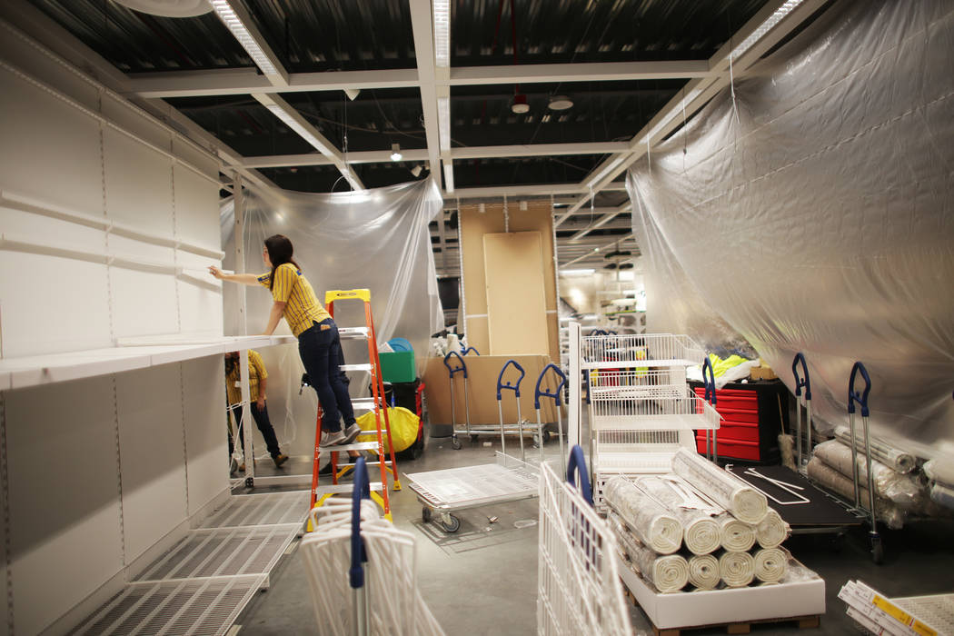 Brittany Marcinkevich remodels a section on Monday, May 15, 2017, in the home textiles area at Ikea in Las Vegas. The one year anniversary of Ikea is Thursday. Ikea is revamping parts of the home  ...