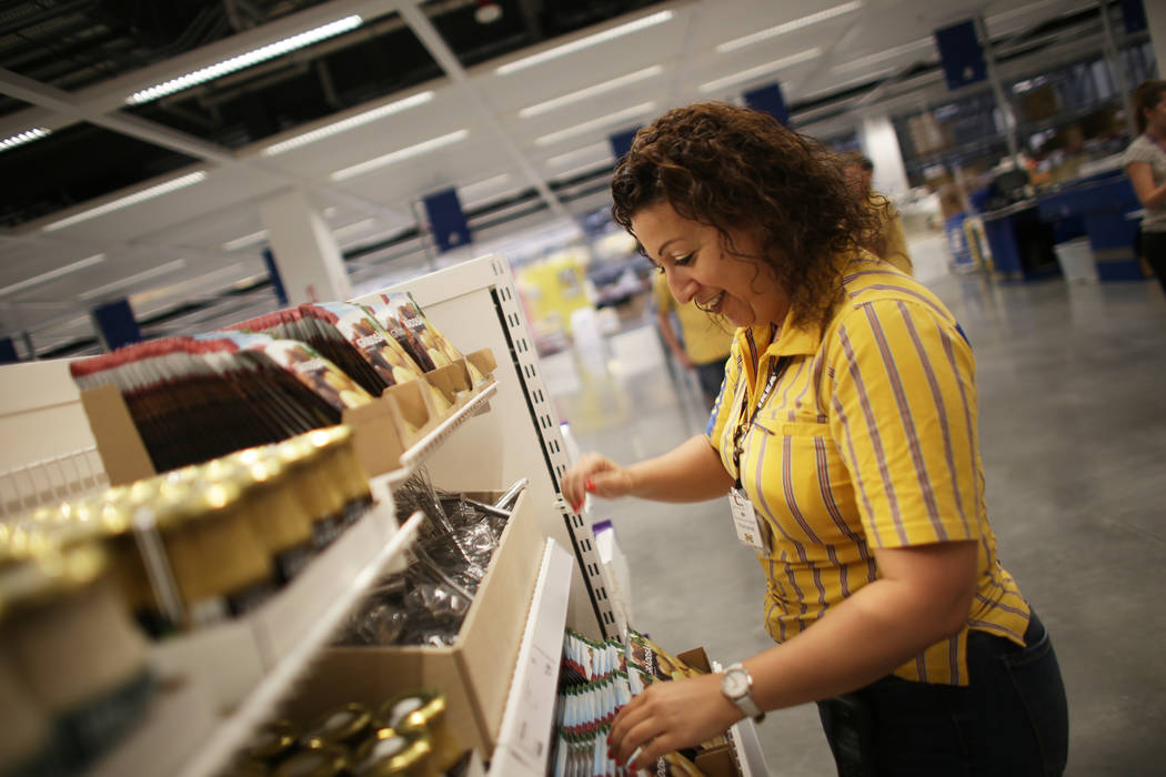 Ida Sarkeesian moves food items on the shelf at the Swedish food section on Monday, May 15, 2017, at Ikea in Las Vegas. The one year anniversary of Ikea is Thursday. Ikea has added birch wood to t ...
