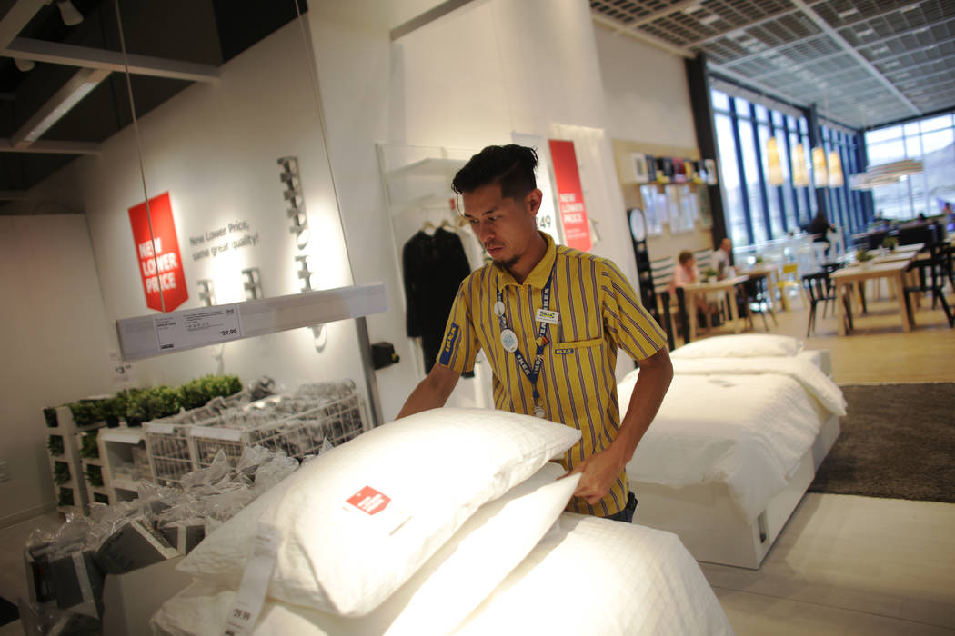Tim Nguyen adjusts pillows on Monday, May 15, 2017, at Ikea in Las Vegas. The one year anniversary of Ikea is Thursday. (Rachel Aston/Las Vegas Review-Journal) @rookie__rae