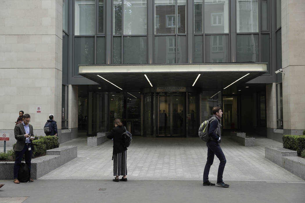 An exterior view shows the main entrance of St Bartholomew's Hospital, in London, one of the hospitals whose computer systems were affected by a cyberattack, Friday, May 12, 2017. (Matt Dunham/AP)