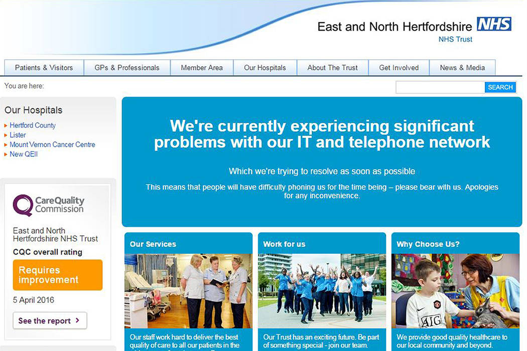 "This is screengrab taken from the website of the East and North Hertfordshire NHS trust as Britain's National Health Service is investigating ""an issue with IT""  Friday May 12, 2017. (PA via AP)"