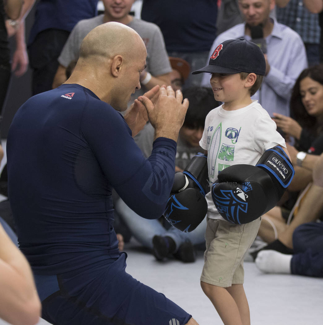 Young fan Eli Morgan gets a moment to throw punches with UFC heavyweight Junior dos Santos at UFC 211 open workouts at the Mohler MMA gym in Dallas, Texas, on Thursday, May 11, 2017. Heidi Fang/La ...