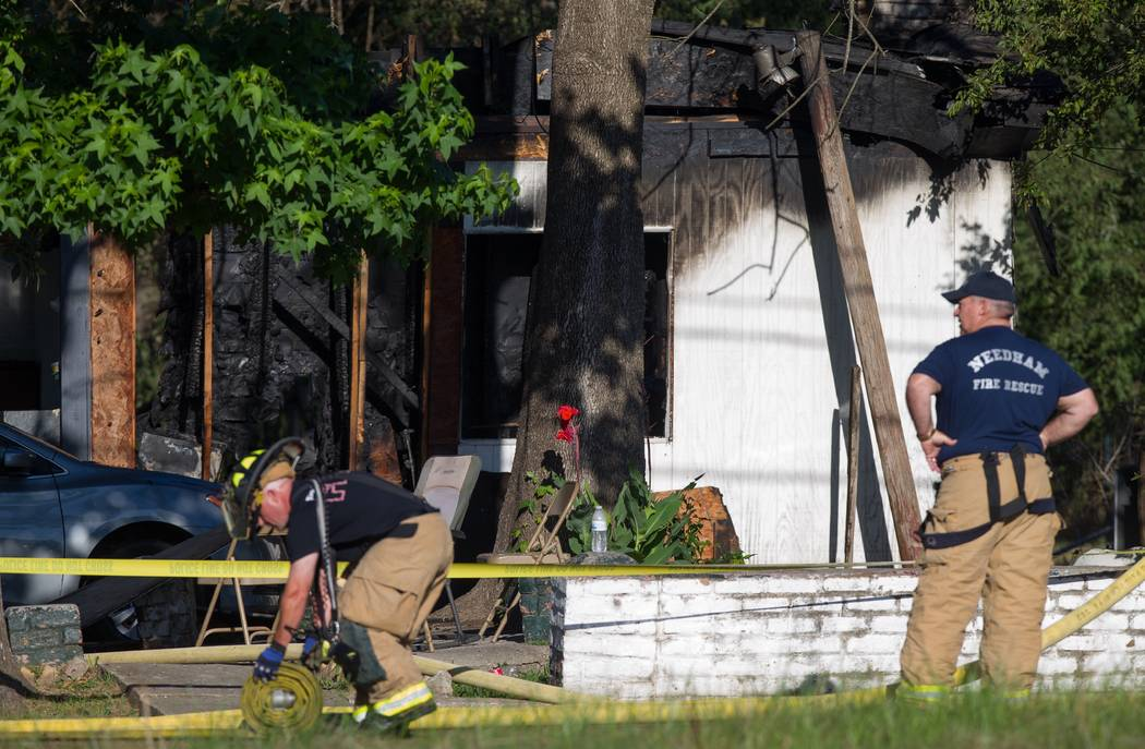 Authorities investigate the scene of a three-alarm fire that killed multiple people and damaged three residences in south Montgomery County Friday, May 12, 2017, in Conroe, Texas. (Godofredo A. Va ...