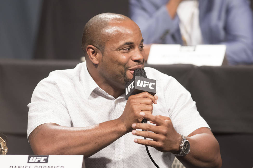 UFC light heavyweight champion Daniel Cormier laughs off trash talk from Jon Jones at the UFC summer kickoff press conference at the American Airlines Center in Dallas, Texas, on Friday, May 12, 2 ...
