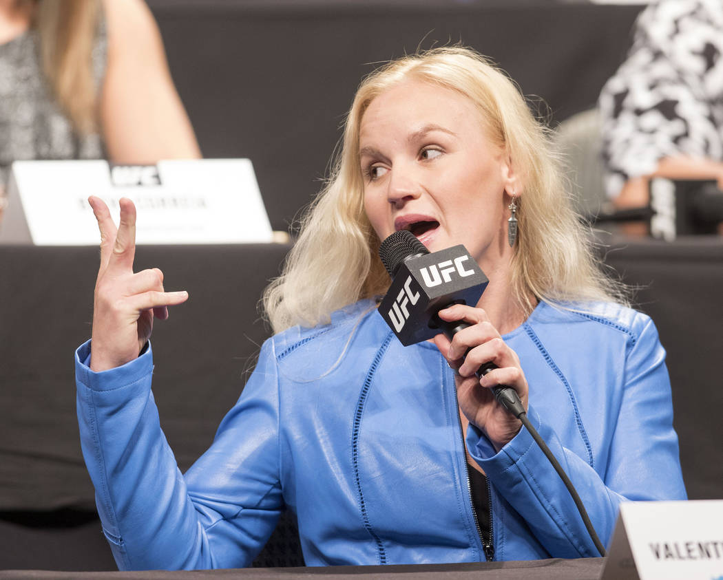 Valentina Shevchenko shows UFC women's bantamweight champion Amanda Nunes (not pictured) how many times she plans to defeat her at the UFC summer kickoff press conference at the American Airlines  ...