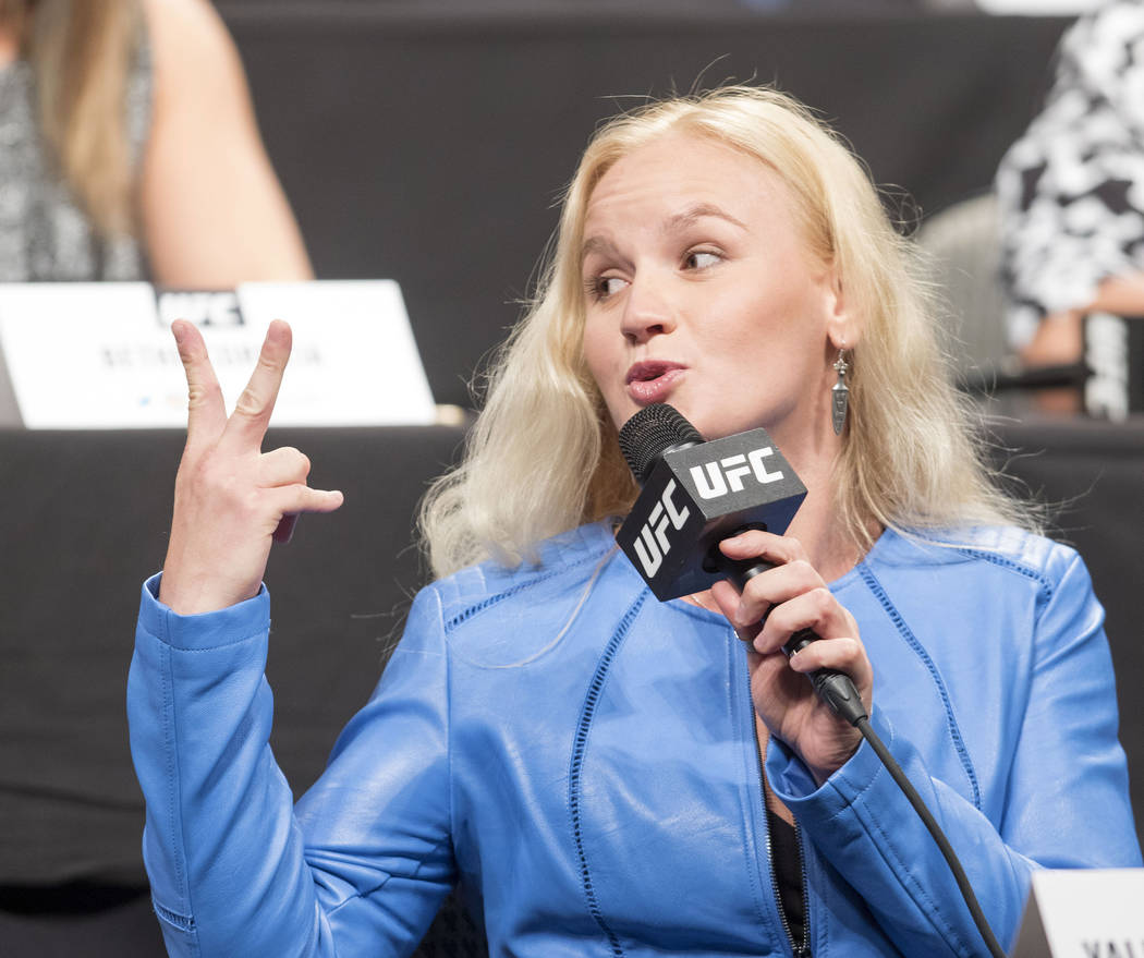 UFC women's bantamweight Valentina Shevchenko holds up fingers to taunt UFC champion Amanda Nunes (not pictured) at the UFC summer kickoff press conference at the American Airlines Center in Dalla ...
