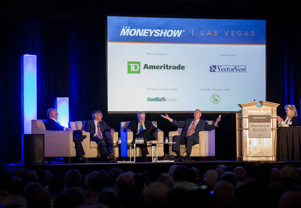 Economists Wayne Root, from left, Stephen Moore, Steve Forbes and Mark Skousen share a moment during a panel discussion as a part of the MoneyShow at Caesars Palace in Las Vegas on Monday, May 15, ...