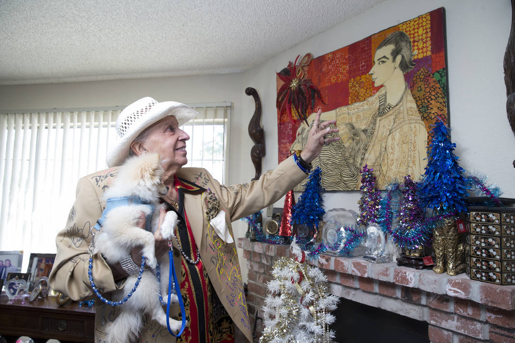 Monti Rock III with his dog Zozo, in a home decorated with paintings and memorabilia devoted to the persona he created in the 1960s. Erik Verduzco Las Vegas Review-Journal @Erik_Verduzco