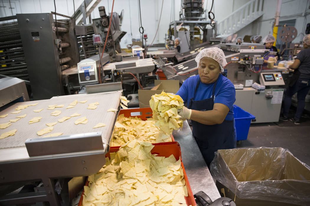 Mirna Vides bags tortilla chips at the T.I. Foods warehouse on Tuesday, May 16, 2017, in North Las Vegas. Erik Verduzco Las Vegas Review-Journal @Erik_Verduzco