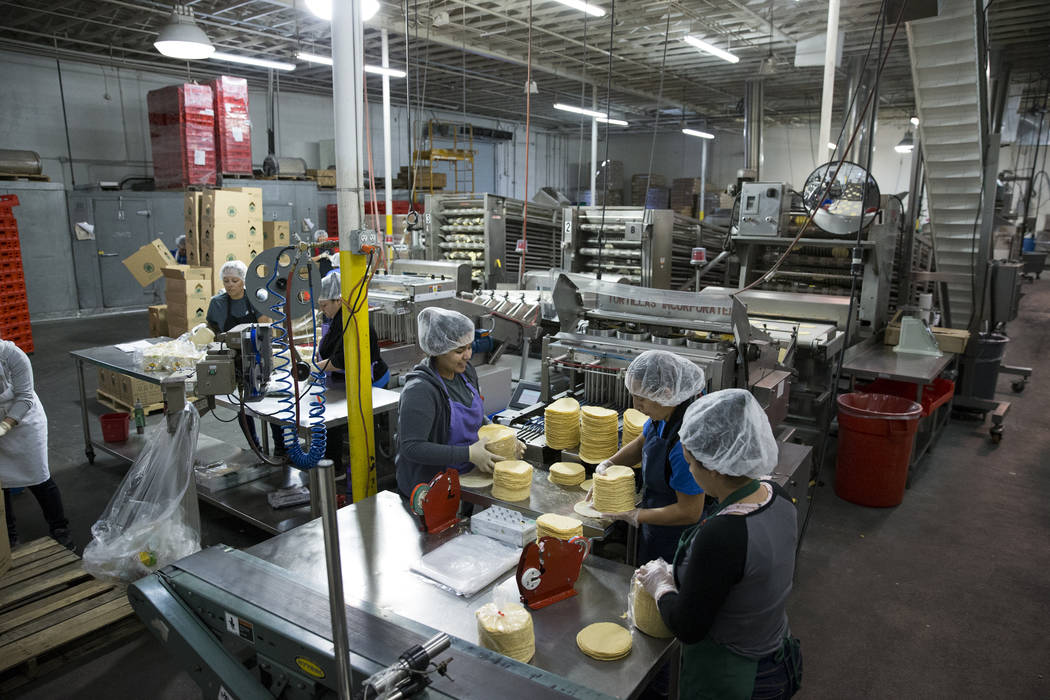 Employees collect tortillas before bagging them in the final stage of the process at the T.I. Foods warehouse on Tuesday, May 16, 2017, in North Las Vegas. Erik Verduzco Las Vegas Review-Journal @ ...