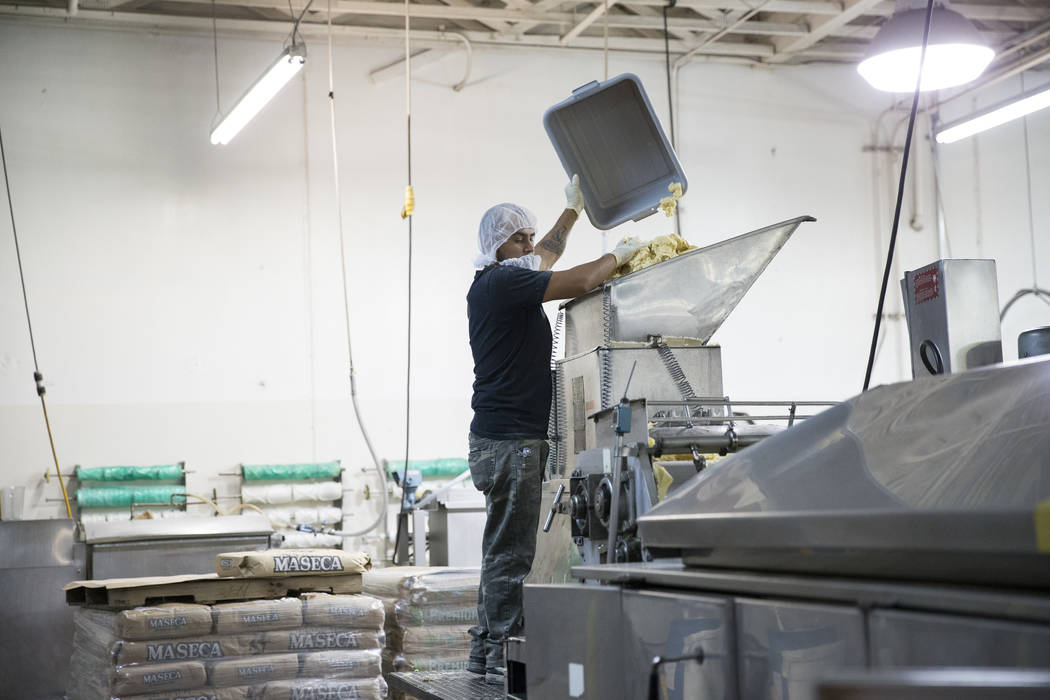 Erik Ramos drops a prepared mix of corn flour to make tortillas at the T.I. Foods warehouse on Tuesday, May 16, 2017, in North Las Vegas. Erik Verduzco Las Vegas Review-Journal @Erik_Verduzco