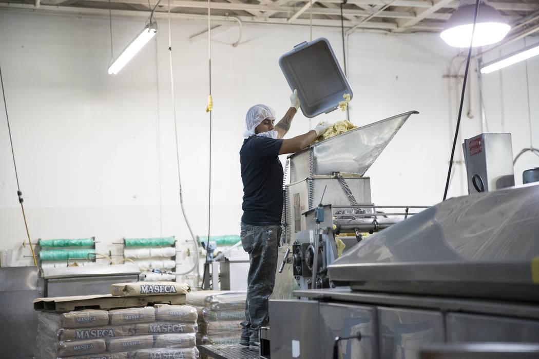 Erik Ramos drops a prepared mix of corn flour to make tortillas at the T.I. Foods warehouse on Tuesday, May 16, 2017, in North Las Vegas. Erik Verduzco Las Vegas Review-Journal @Erik_Verduzco