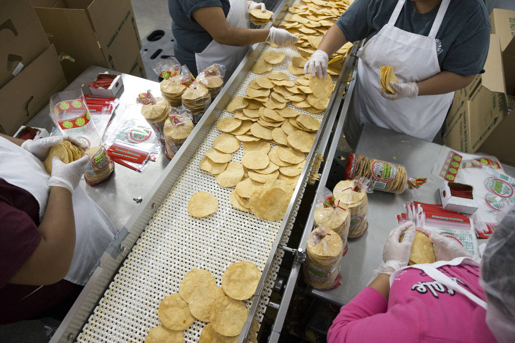 Employees bag tostadas at the T.I. Foods warehouse on Tuesday, May 16, 2017, in North Las Vegas. Erik Verduzco Las Vegas Review-Journal @Erik_Verduzco