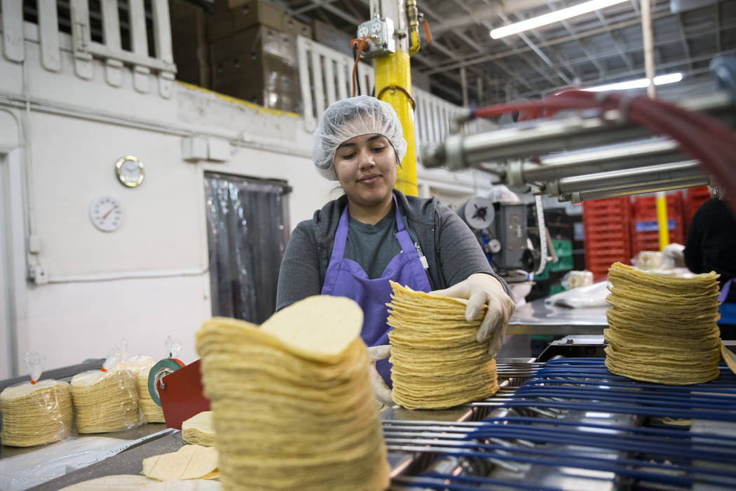 Sandra Castillas grabs a batch of tortillas before bagging them at the T.I. Foods warehouse on Tuesday, May 16, 2017, in North Las Vegas. Erik Verduzco Las Vegas Review-Journal @Erik_Verduzco