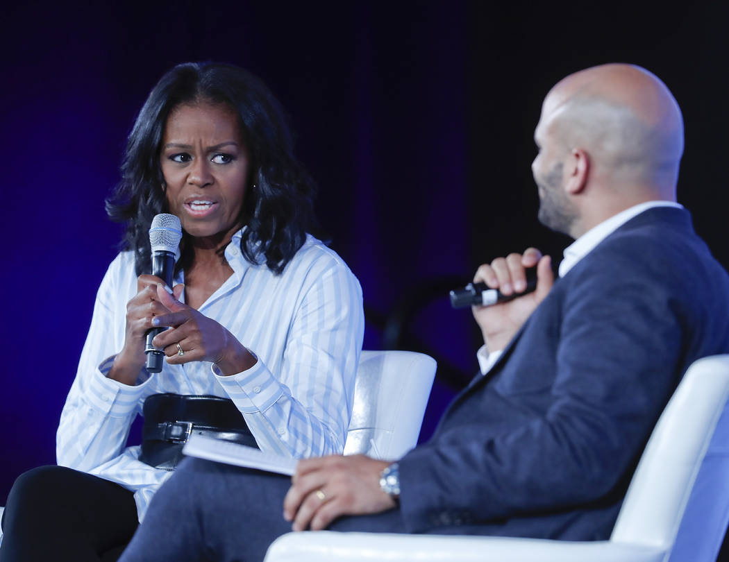 Former first lady Michelle Obama talks with Sam Kass, former White House Chef and Senior Policy Advisor for Nutrition, at the Partnership for a Healthier American 2017 Healthier Future Summit in W ...