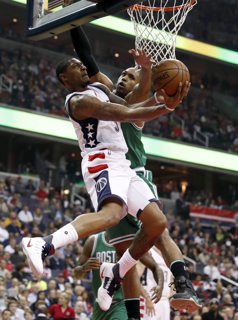 Washington Wizards guard Bradley Beal (3) shoots in front of Boston Celtics center Al Horford during the first half of Game 6 of an NBA basketball second-round playoff series, Friday, May 12, 2017 ...