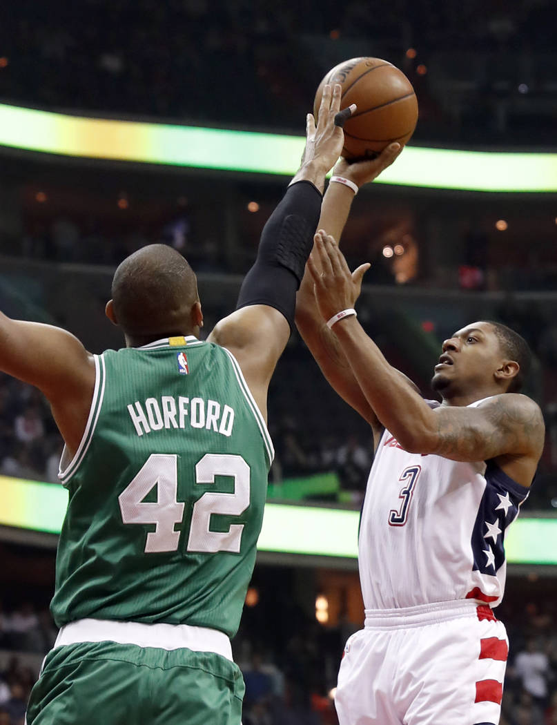 Washington Wizards guard Bradley Beal (3) shoots over Boston Celtics center Al Horford (42) during the first half of Game 6 of an NBA basketball second-round playoff series Friday, May 12, 2017, i ...