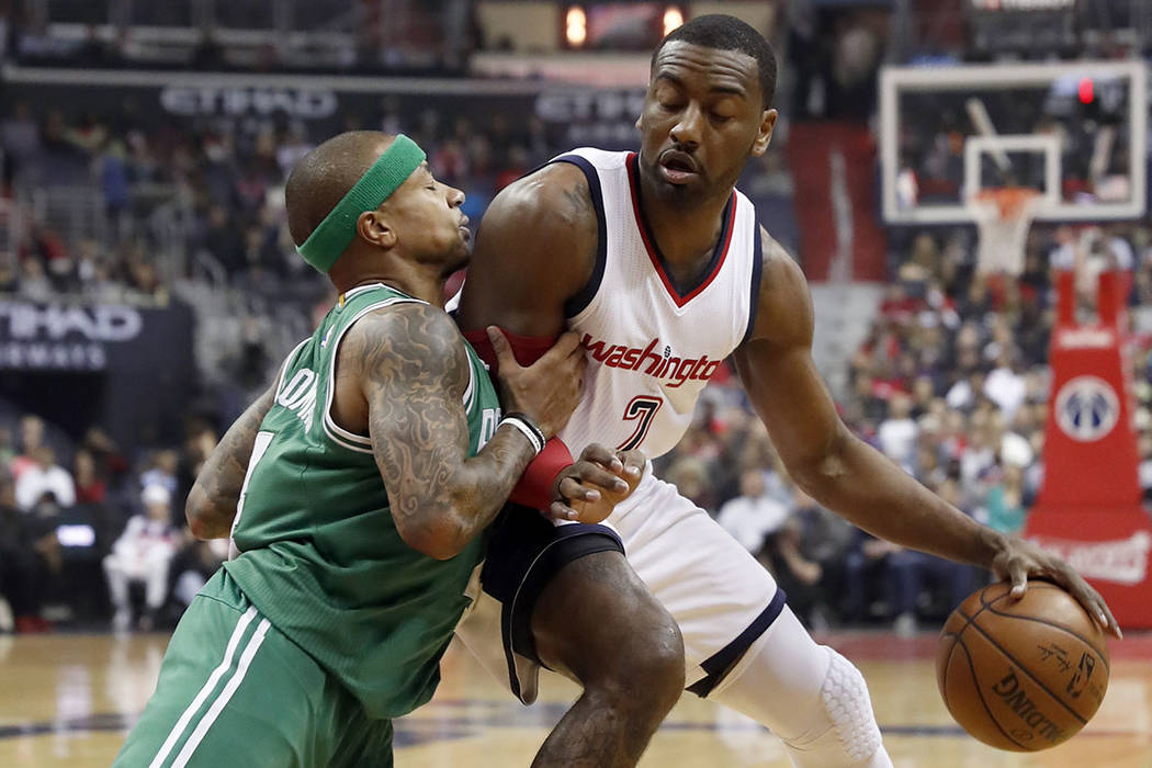 Boston Celtics guard Isaiah Thomas, left, pushes against Washington Wizards guard John Wall during the first half of Game 6 of an NBA basketball second-round playoff series, Friday, May 12, 2017,  ...