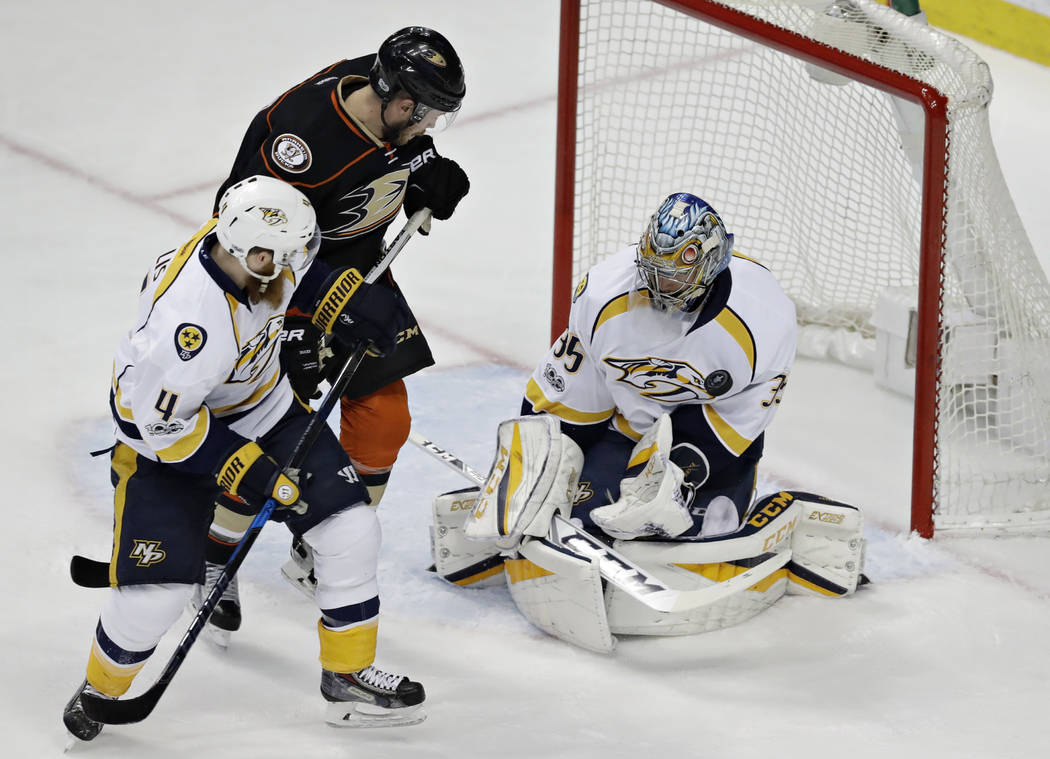 Nashville Predators goalie Pekka Rinne blocks a shot by Anaheim Ducks' Chris Wagner, center, during the first period of Game 1 in the NHL hockey Stanley Cup Western Conference finals, Friday, May  ...