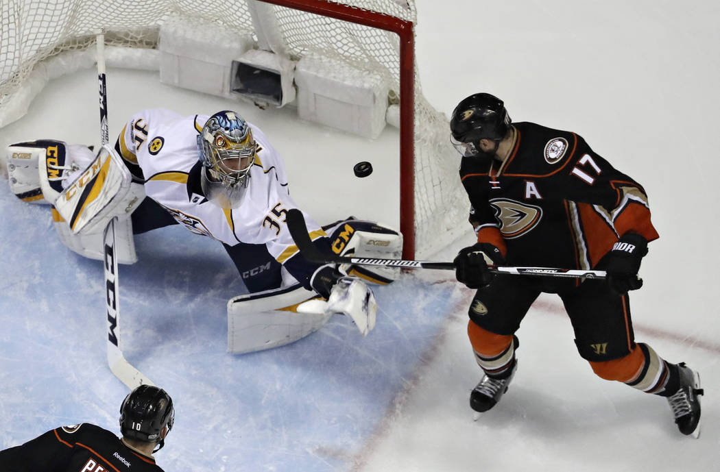 Nashville Predators goalie Pekka Rinne, top left, blocks a shot by Anaheim Ducks center Ryan Kesler during the second period of Game 1 in the NHL hockey Stanley Cup Western Conference finals, Frid ...