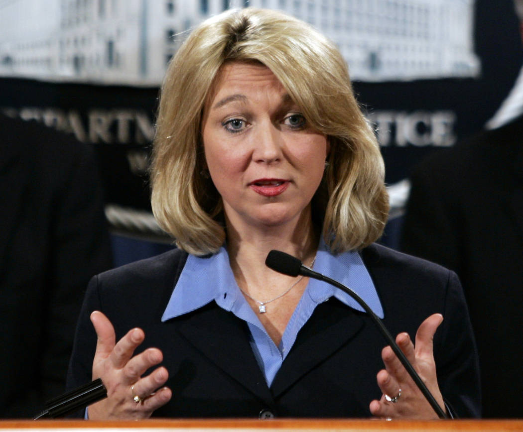 In this Jan. 3, 2006, file photo, then-Assistant Attorney General for the Criminal Division Alice Fisher briefs reporters at the Justice Department in Washington. President Donald Trump is conside ...