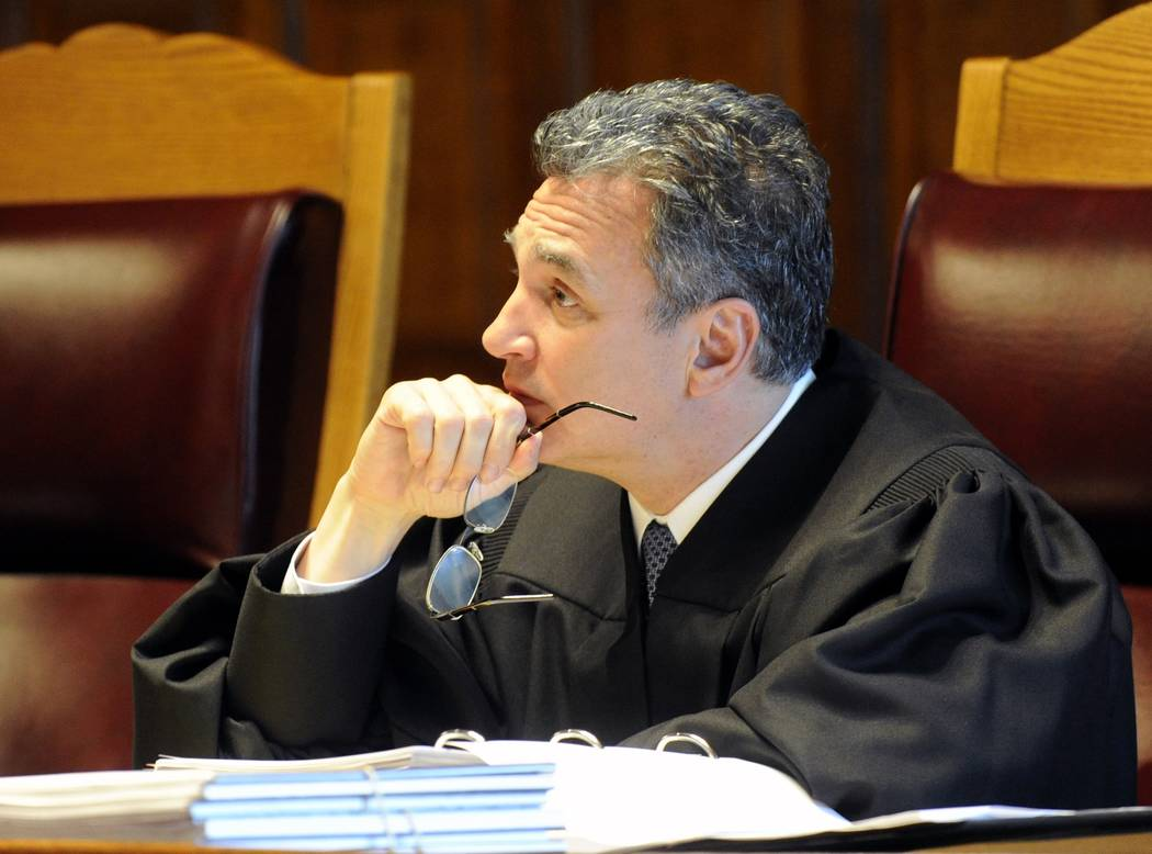 In this June 1, 2016, file photo, New York Court of Appeals Associate Judge Michael J, Garcia, listen to oral arguments on whether criminal defendants should be allowed to use allegations made in  ...