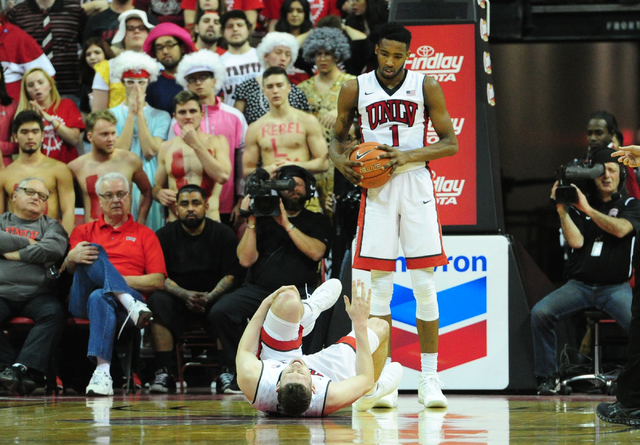 UNLV forward Ben Carter (13) lies injured on the floor as Derrick Jones Jr. (1) looks on in the first half of their NCAA college basketball game at the Thomas & Mack Center in Las Vegas Saturd ...