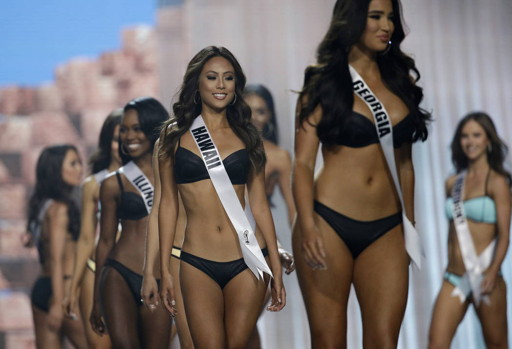 In this May 11, 2017, photo, Miss Hawaii USA Julie Kuo competes during a preliminary competition for Miss USA in Las Vegas. Kuo was born in Tainan, Taiwan, and moved to Hawaii with her family. Fiv ...