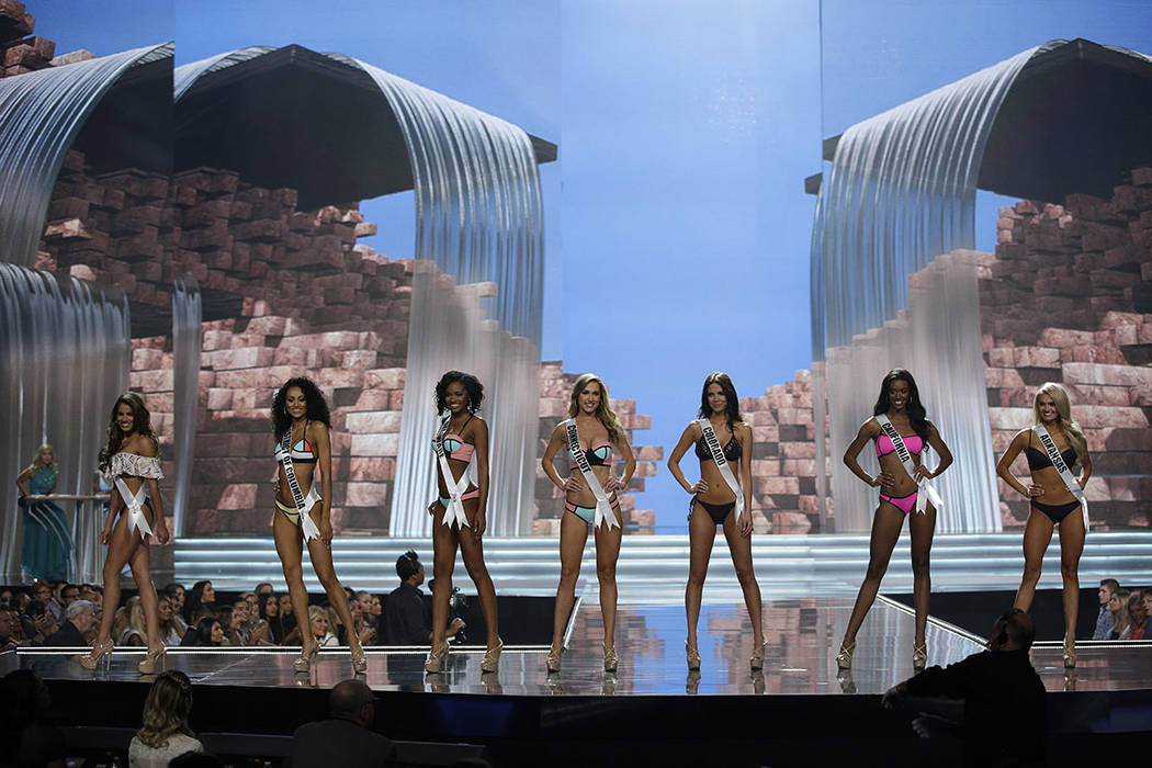 CORRECTS NAME TO LITVINENKO ON SECOND REFERENCE In this May 11, 2017, photo, Miss Connecticut USA Olga Litvinenko, center, competes with others during a preliminary competition for Miss USA in Las ...