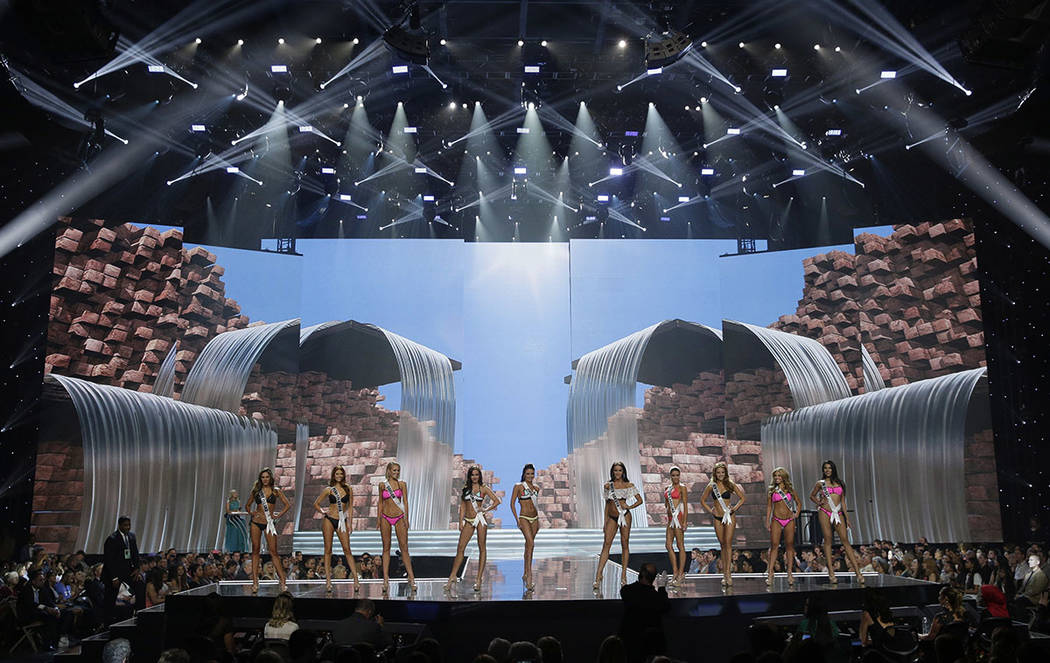 In this May 11, 2017, photo, People including Miss North Dakota USA Raquel Wellentin, center right, compete during a preliminary competition for Miss USA in Las Vegas. Wellentin emigrated from the ...