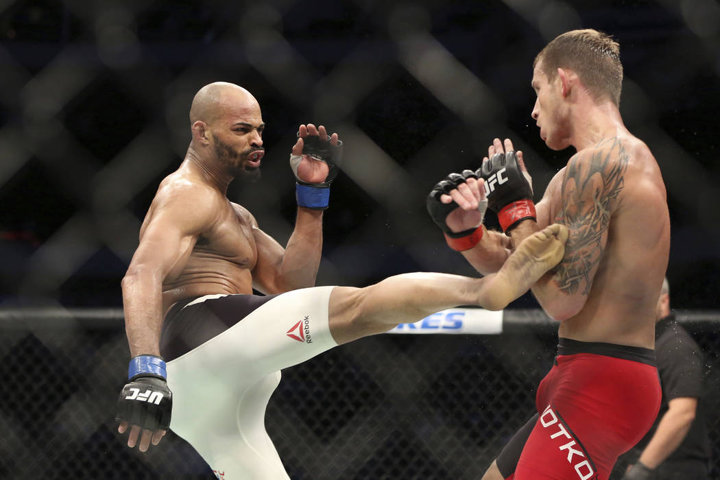 Kryzsztof Jotko, right,, fights David Branch in a mixed martial arts bout at UFC 211 on Saturday, May 13, 2017, in Dallas. Branch won via decision. (AP Photo/Gregory Payan)