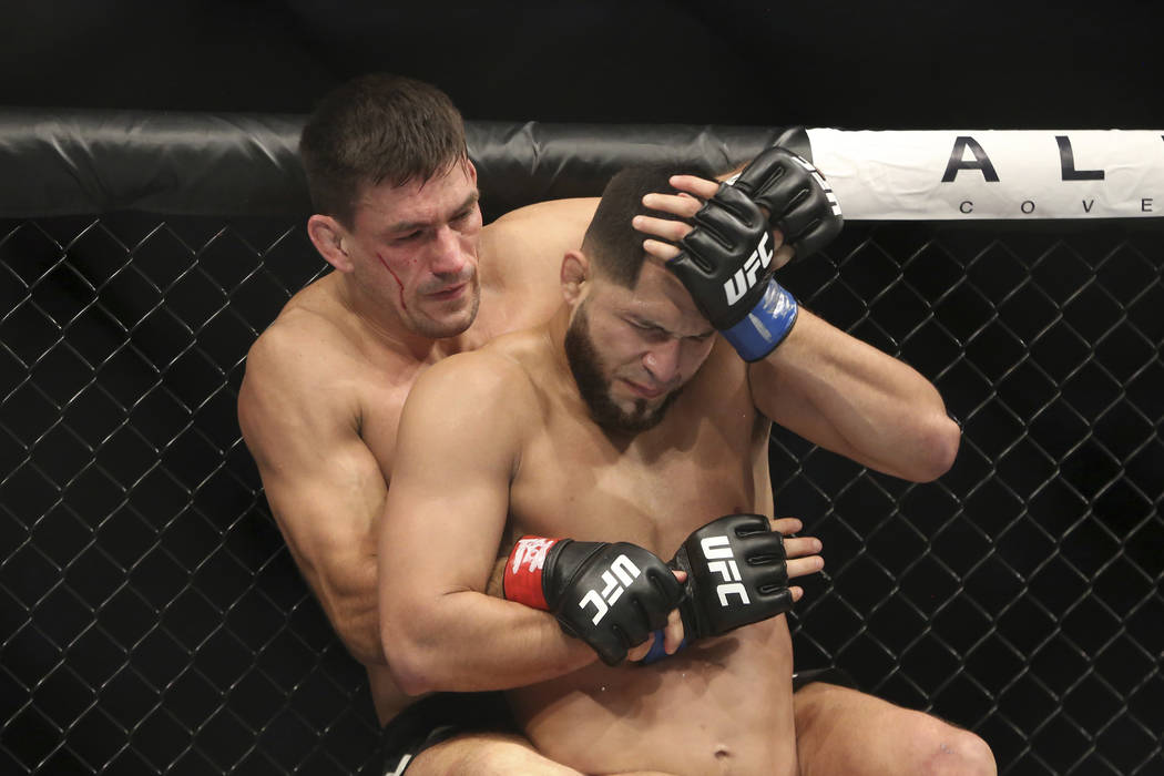Demian Maia, top, fights Jorge Masvidal in a mixed martial arts bout at UFC 211 on Saturday, May 13, 2017, in Dallas. Maia won via split decision. (AP Photo/Gregory Payan)