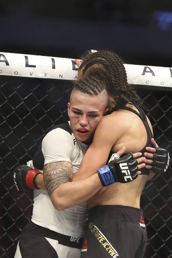Joanna Jedrzejczyk, right, hugs Jessica Andrade after their mixed martial arts bout at UFC 211 for the UFC Women's strawweight championship, Saturday, May 13, 2017, in Dallas. Jedrzejczyk retained ...