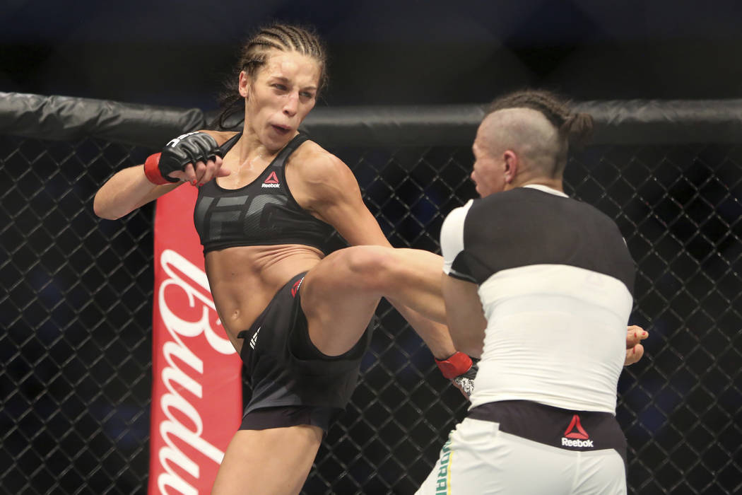 Joanna Jedrzejczyk, left, fights Jessica Andrade in a mixed martial arts bout at UFC 211 for the UFC women's strawweight championship, Saturday, May 13, 2017, in Dallas. Jedrzejczyk retained her t ...