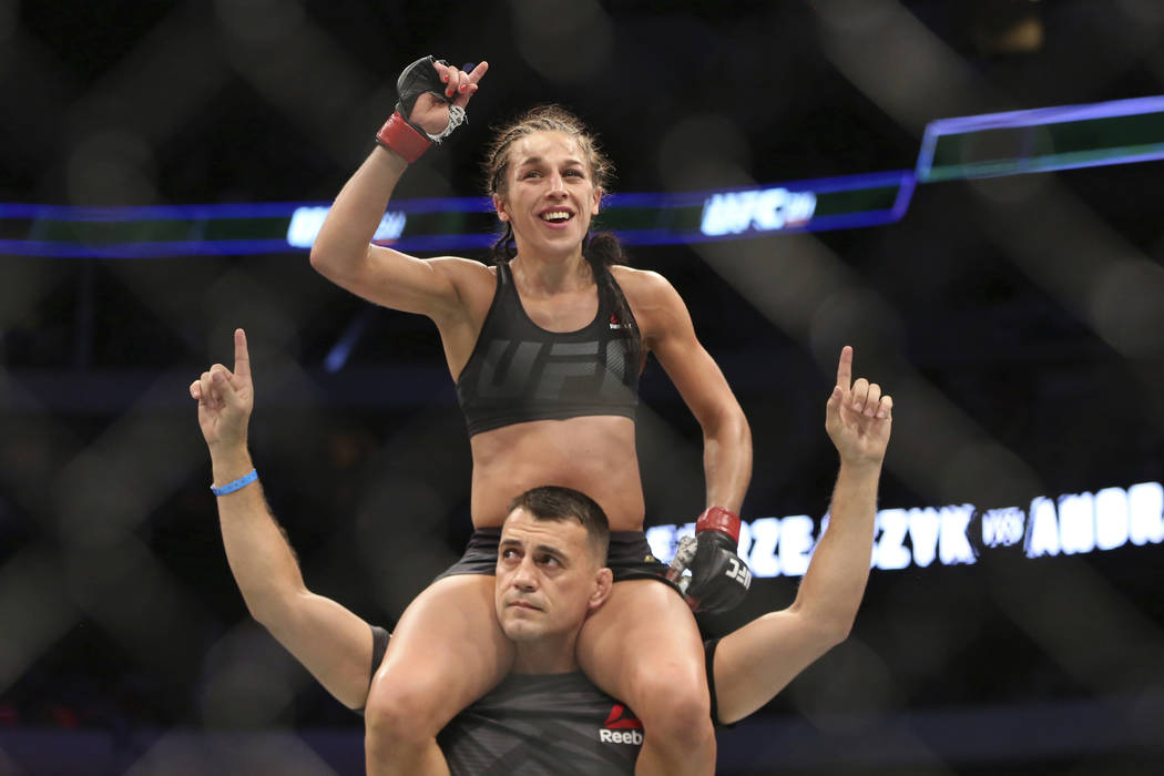 Joanna Jedrzejczyk, celebrates after defeating Jessica Andrade in a mixed martial arts bout at UFC 211 for the UFC women's strawweight championship, Saturday, May 13, 2017, in Dallas. Jedrzejczyk  ...