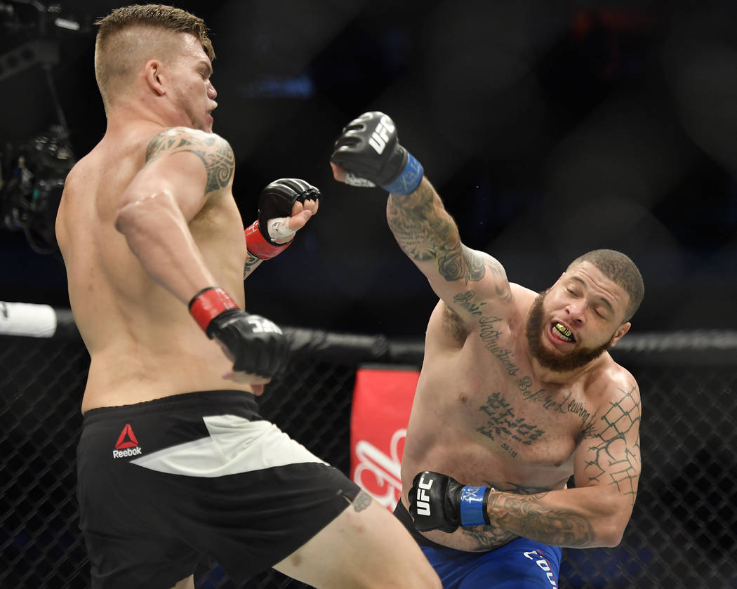 May 13, 2017; Dallas, TX, USA; Chase Sherman (red gloves) fights Rashad Coulter (blue gloves) during UFC 211 at American Airlines Center. Mandatory Credit: Jerome Miron-USA TODAY Sports