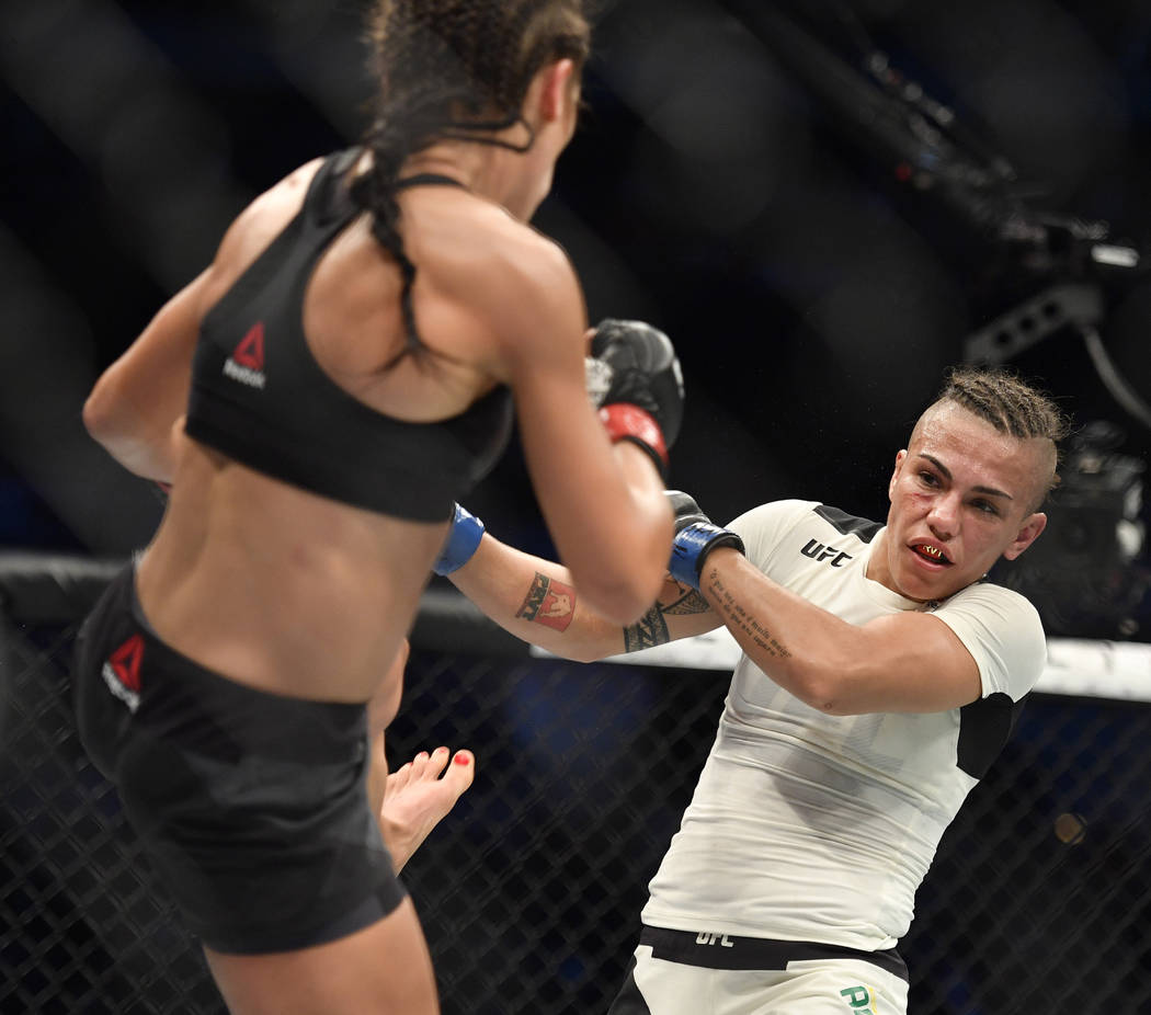 May 13, 2017; Dallas, TX, USA;Joanna Jedrzejczyk (red gloves) fights Jessica Andrade (blue gloves) during UFC 211 at American Airlines Center. Mandatory Credit: Jerome Miron-USA TODAY Sports