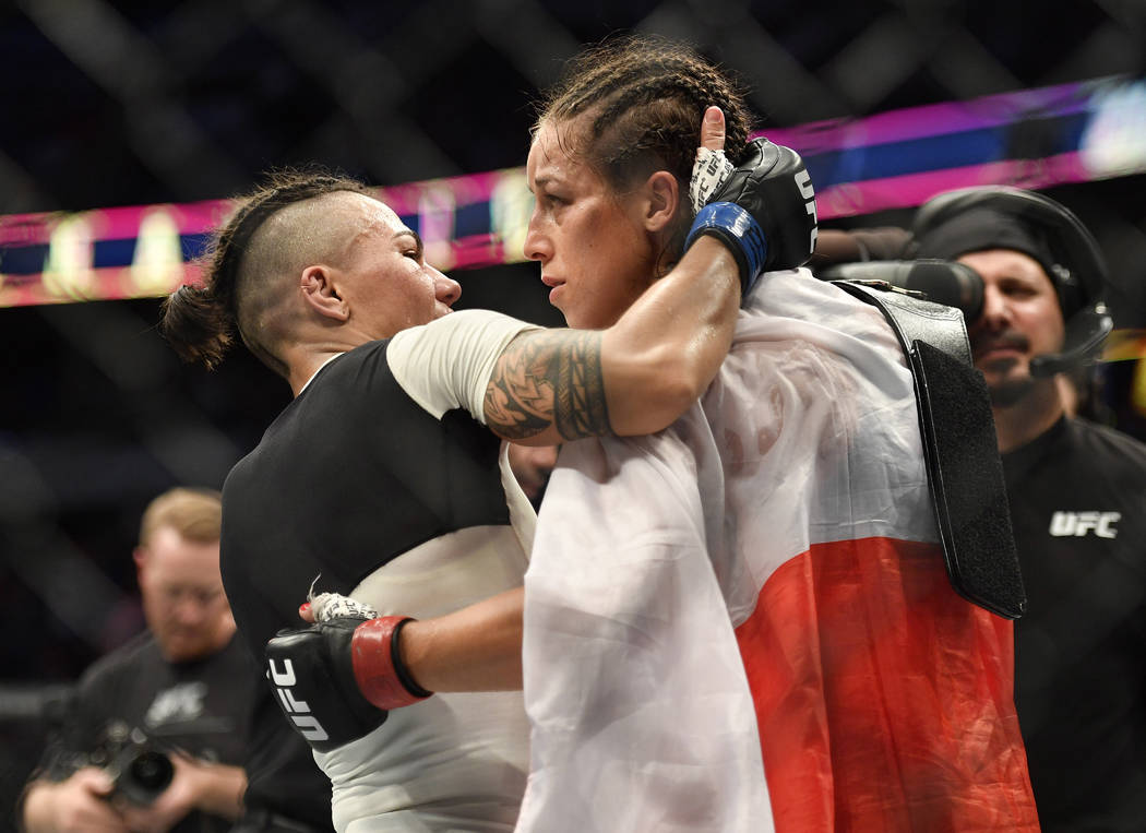 May 13, 2017; Dallas, TX, USA; Joanna Jedrzejczyk (red gloves) defeats Jessica Andrade (blue gloves) during UFC 211 at American Airlines Center. Mandatory Credit: Jerome Miron-USA TODAY Sports